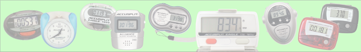 A grouping of different older pedometers.